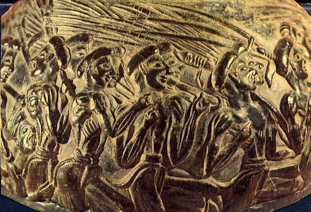 A master sculpted this fool: A Minoan harvester at left trips and falls in a raucous music-accompanied parade with their olive poles. One side of the 'Harvesters Vase' from Agia Triada, Crete (c. LMI or 1600BCE, Heraklion Museum)